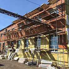 Устройство утеплителя на фасаде здания цеха
