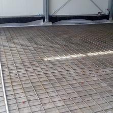 Подготовка к устройству бетонного пола. Укладка армированной сетки.