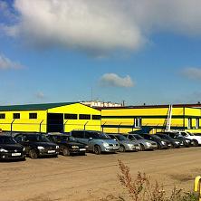 Здание нового производственного цеха и здание магазина после реконструкции